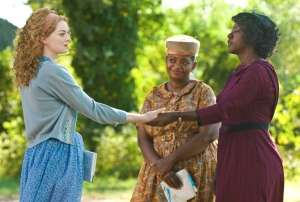 """THE HELP"" 946_D_08558R In Jackson, Mississippi in 1963, (left to right) Skeeter Phelan (Emma Stone), Minnie Jackson (Octavia Spencer) and Aibileen Clark (Viola Davis) together take a risk that could have profound consequences for them all in DreamWorks Pictures' drama, ""The Help"", based on the New York Times best-selling novel by Kathryn Stockett. Ph: Dale Robinette ©DreamWorks II Distribution Co., LLC.  All Rights Reserved."